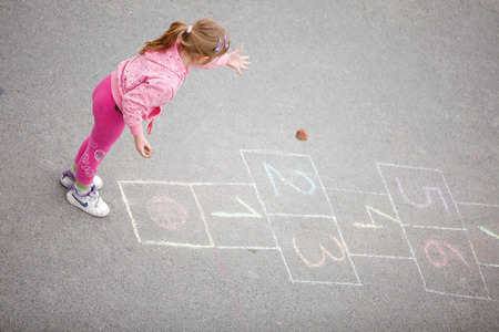 beautiful little girl on the hopscotch photo