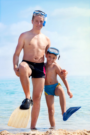 Father and son ready to dive in the sea photo