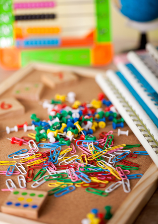 pinhead: Colorful pinhead and paperclips on shool table Stock Photo