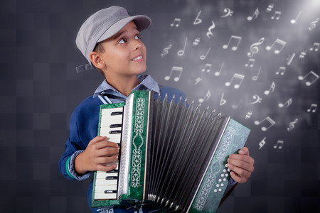 young happy musician playing the accordion photo