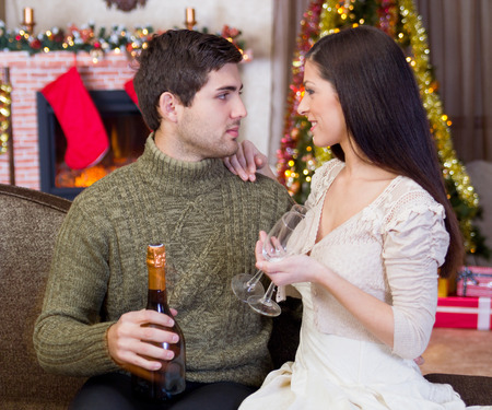 couple holding glasses with champagne and celebrate Christmas night  photo