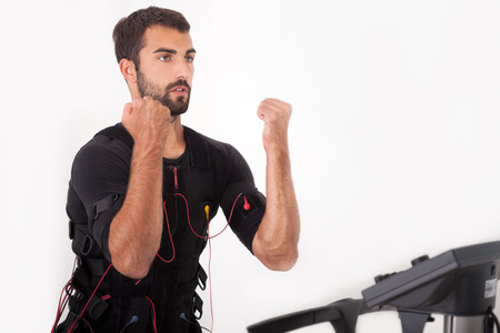 stimulator: man working on electro muscular stimulation machine Stock Photo