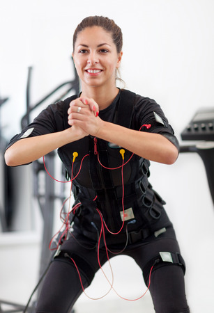 stimulator: fit young woman exercise key position of speedfitness sequence Stock Photo
