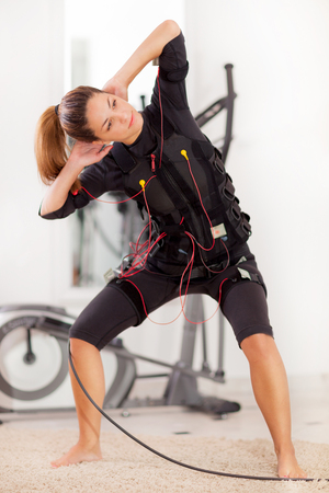 fit woman exercise on electro muscular Standard-Bild