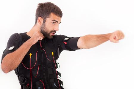stimulator: man working on electro muscular stimulation machine