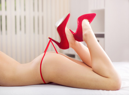 naked legs: part of naked woman with red panties