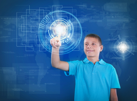 schoolkid search: young happy boy working with digital virtual screen Stock Photo