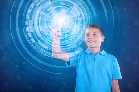 schoolkid search: little genius working on the virtual program Stock Photo
