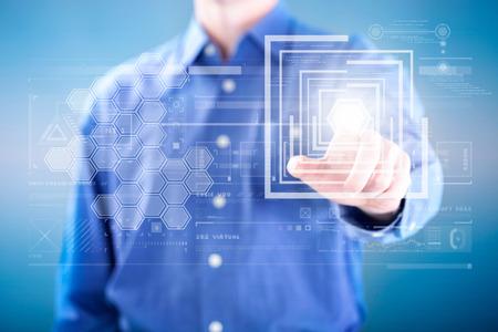 design concept: man pressing on button of digital virtual screen