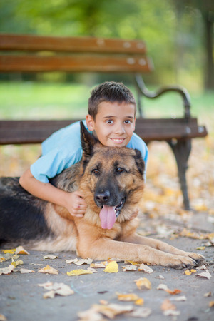 boy in the park with a German Shepherd photo