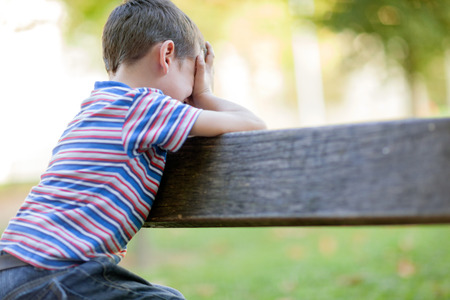 alone boy: lonely young orphan in park crying