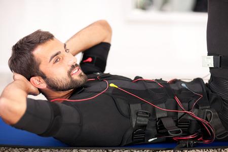 man working on electro muscular stimulation machine Standard-Bild