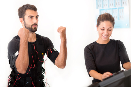 ems: man exercise with ems stimulation