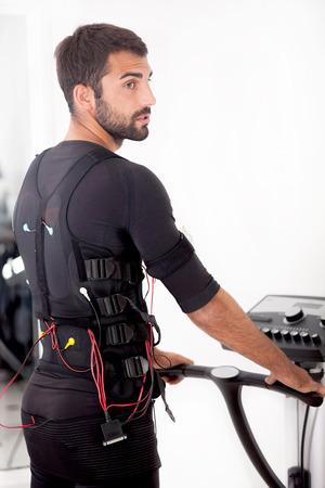 stimulator: man exercise with ems stimulation