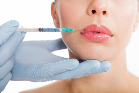 injuring: Botox shot in the female cheek,