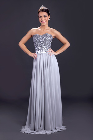 avantegarde: Beautiful elegant young bride in gray long dress