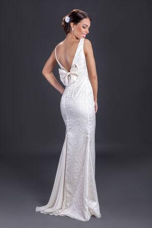 avantegarde: Beautiful woman wearing white dress