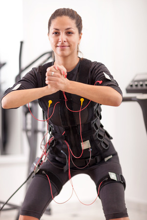 stimulation: ems electro muscular stimulation exercise Stock Photo
