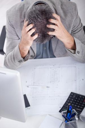 exerted: Mature business man having a stress. Headache.