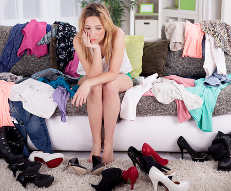 worried woman: depressed young girl does not know what to wear