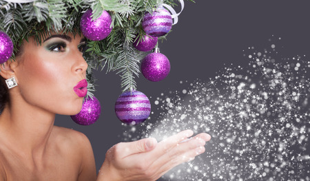 christmas tree purple: Christmas fashion model woman. Xmas New Year hairstyle and make up Stock Photo