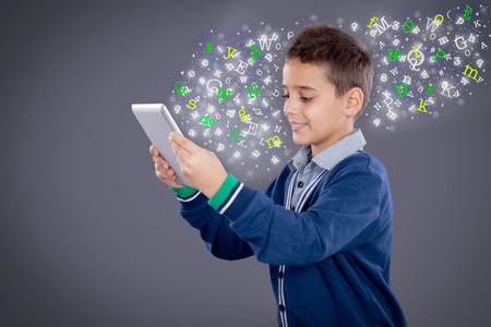 electronic background: child is looking at a computer tablet