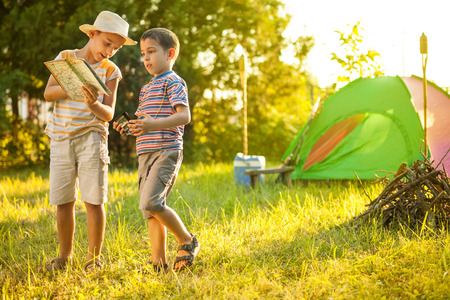 brother: Camp in the tent - two brothers on the camping