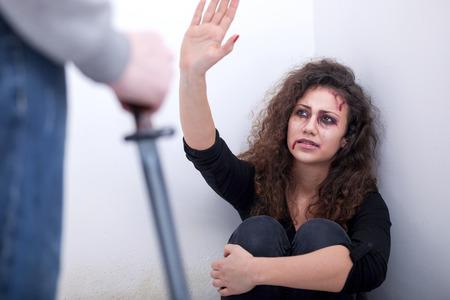 maniac: Husband holding a knife intimidates his wife