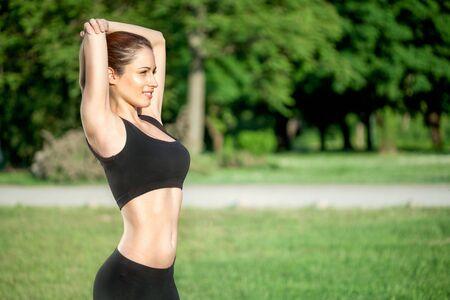 cardiovascular exercising: beautiful sport woman stretching outdoor
