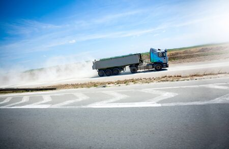 18 wheeler: truck on road transporting cargo Stock Photo
