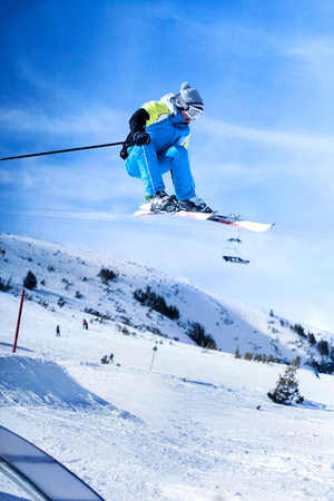skier jumping: extreme sport,jumping skier in blue suit Stock Photo