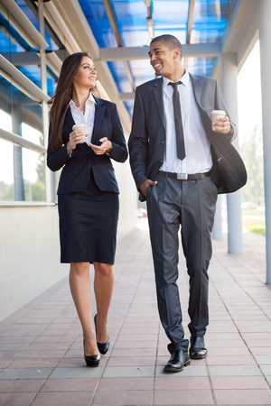 coffe break: smiling business man and woman on coffe break  over office building