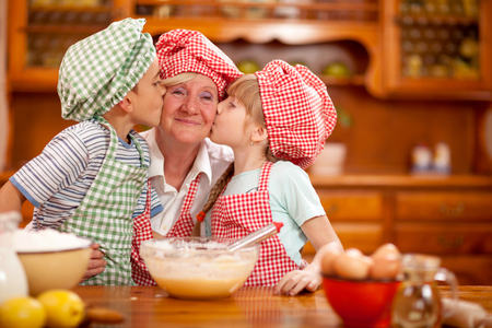 grandmother and grandson: Grandmother,grandson And Granddaughter chef Baking In Kitchen Stock Photo