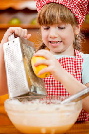 mess: funny young child making mess in kitchen