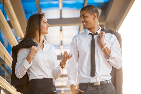 smiling business man and woman on break ,walking around and talking Stock Photo