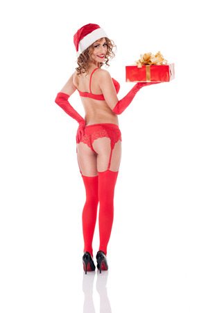 sex santa: Sexy Ms. Santa Claus in red underwear delivers a Christmas present,isolated