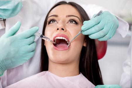 anesthetize: close up of Dentist give syringe anesthetize