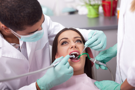 stomatologist: dentist working with woman patient Stock Photo