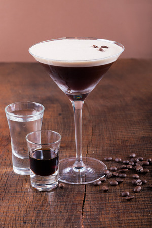 espresso: Coffee Martini cocktail on wooden background