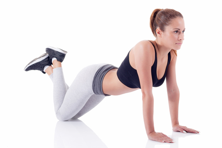 karemat: young girl exercise and stretching