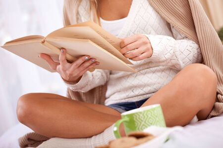 legwarmers: young smiling girl  in bed and enjoy the book