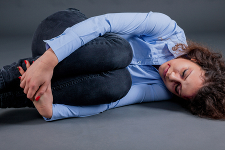 defenseless: scared and battered women,concept of violence over women Stock Photo