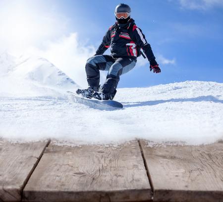 winter sport: snowboarder, extreme winter sport on blue sky
