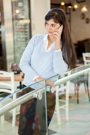 sidewalk talk: businesswoman talking on the mobile phone