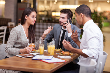 fast food restaurant: Business people Having Meeting In fast food Restaurant