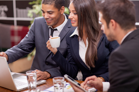 casual business man: Creative young business team in meeting a cafe