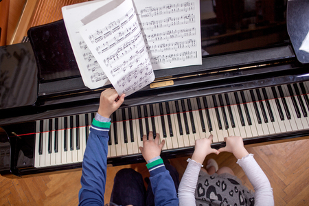 boy 12 year old: Brother And Sister Playing Piano