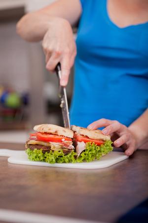 junk food,woman preparing burger photo