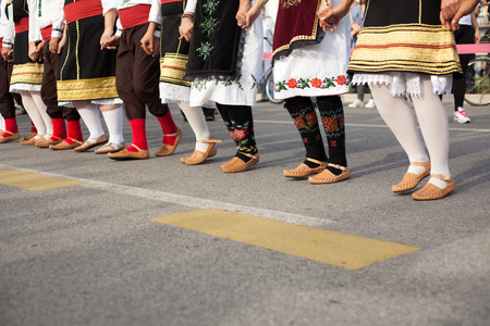 serbian: traditional clothing  preforming Serbian national dances.
