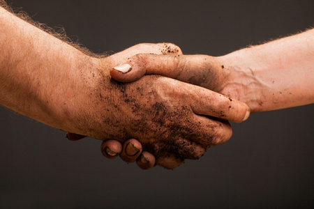 Close up of two male workers hands making deal